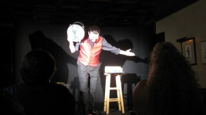 Magician John Shore waits for the applause to die down at the end of an exclusive peice of magic at the Kentucky Magic Dinner Theater