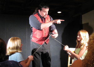 Magician John Shore working with audience members during a performance of The Kentucky MAgic Dinner Theater